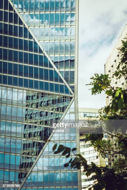 parisian la défense business district office buildings - louvre pyramid stock photos and pictures