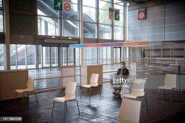 Parisian waits to be called for vaccination in Paris' latest mass-vaccination centre at the National Exhibition Centre on the first day that Covid-19...