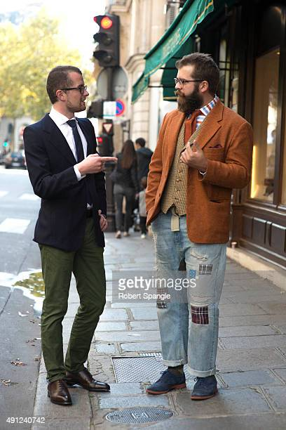 Parisian wears blue jacket with green moleskin trousers Parisian wears orange cordory jacket with patchwork denim and blue suede shoes on Rue...