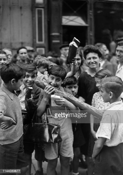 Parisians are happy to eat white bread which they can buy again after years of rationing in August 1944 after the Liberation of Paris