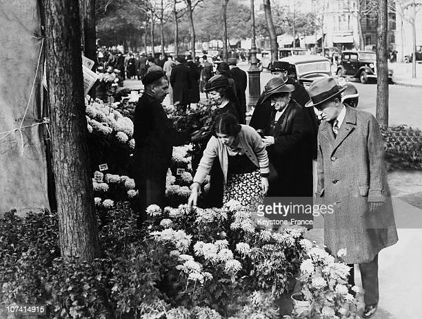 Parisians Buying Chrysanthemums For The All Saints Day
