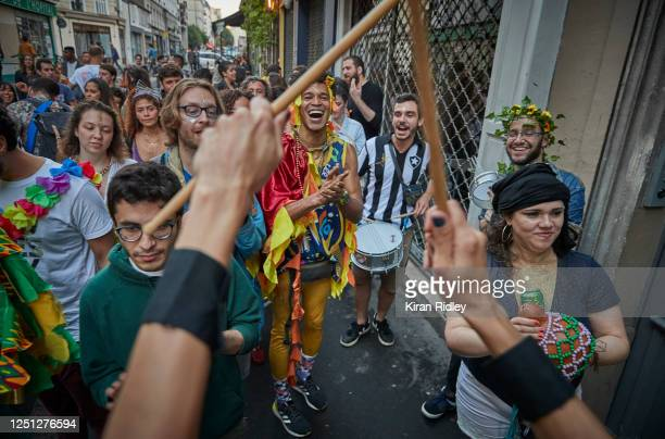 Parisians dance in the street near the Canal St Martin as Paris celebrates the first day of summer with Fete de La Musique with bands playing across...