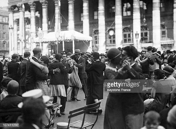 Parisians Dancing In The Street For The French National Holiday In Paris On July 14Th 1930