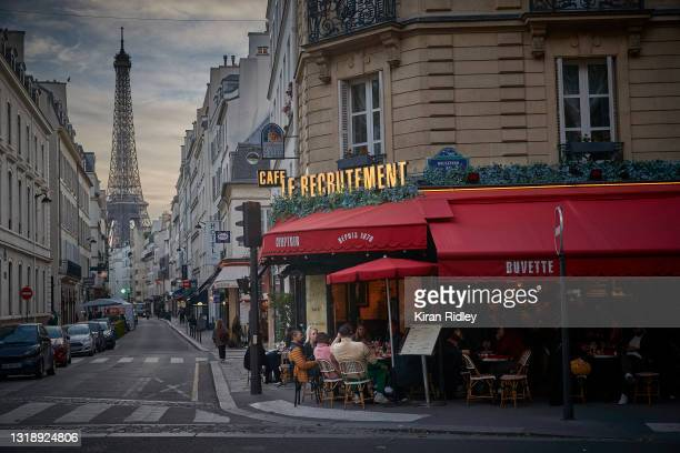 Parisians embrace the lifting of Covid-19 restrictions as cafes and restaurants across France re-open for the first time in over 6 months on May 19,...