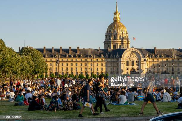 Parisians gather and sit on the grass at Les Invalides, on May 29, 2020 in Paris, France. The coronavirus pandemic has spread to many countries...