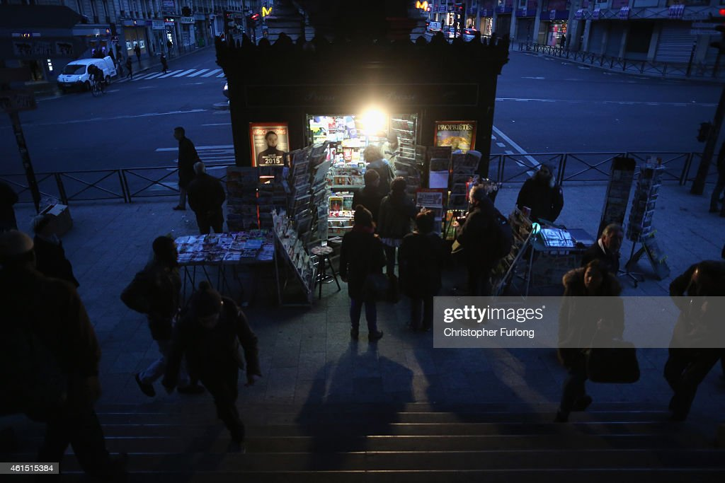 Parisians queue at a newspaper kiosk to get their copies of the latest edition of Charlie Hebdo magazine only to find it is completely sold out on January 14, 2015 in Paris, France. Three million copies of the controversial magazine have been printed in the wake of last week's terrorist attacks.