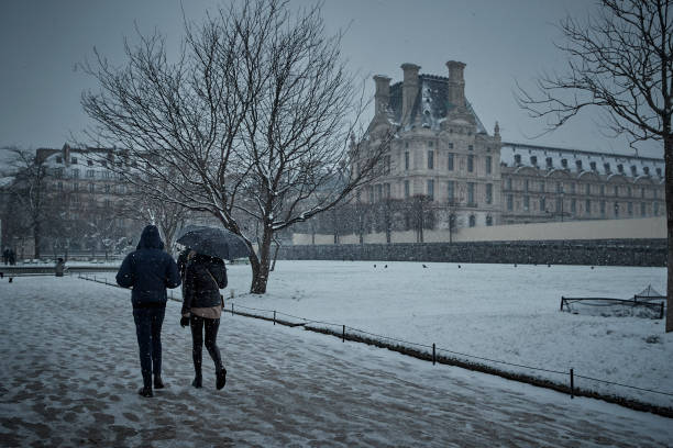 FRA: Paris Dusted In First Snow Of Year