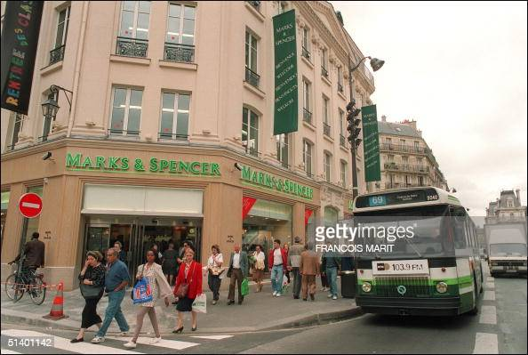 285f64e703d0e Parisiens pass by a Marks   Spencer store situated Pictures