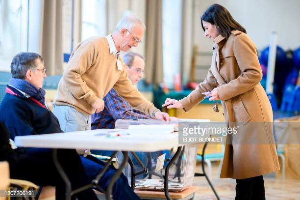 Paris'incumbent mayor and Socialist party's candidate Anne Hidalgo prepares to cast her ballot during the first round of the French municipal...