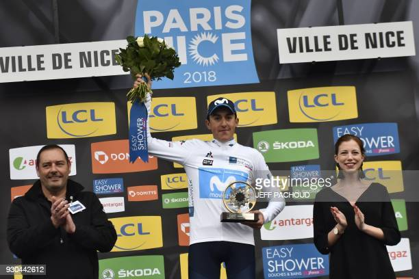 ParisNice 2018 winner Spain's Marc Soler celebrates his best young's white jersey on the podium at the end of the 110 km eighth and last stage of the...