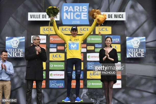 ParisNice 2018 winner Spain's Marc Soler celebrates his overall leader yellow jersey on the podium at the end of the 110 km eighth and last stage of...
