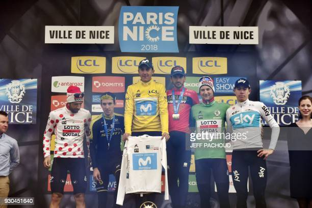 ParisNice 2018 winner Spain's Marc Soler celebrates his overall leader yellow jersey and his best young's white jersey secondplaced Great Britain's...