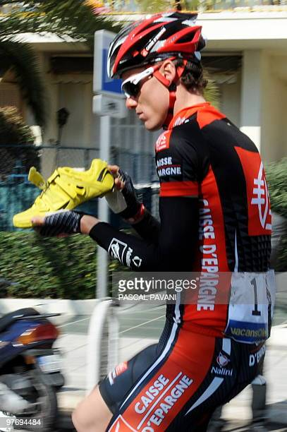 ParisNice winner Spanish Caisse d'Epargne's Spain's Luis Leon Sanchez looks inside his shoe on March 14 2010 in Nice at the start of the 119 km and...