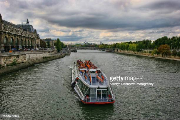 paris-notre dame - tourboat stock pictures, royalty-free photos & images