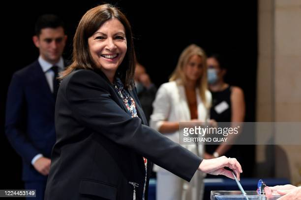 Paris's Mayor Anne Hidalgo casts her ballot during a council meeting that will officially elect her at the Paris city hall in Paris after she won the...