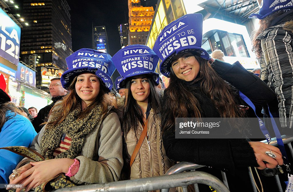 Parita Mohado of Egypt, Aia Sasih of Iran and Nanissa Madadi of Iran join thousands of revelers gathered in New York's Times Square to celebrate the ball drop at the annual New Years Eve celebration on December 31, 2011 in New York City.