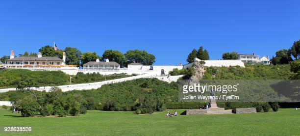 park against clear blue sky during sunny day - mackinac island stock pictures, royalty-free photos & images