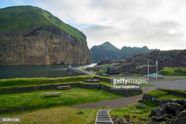 A park alongside the fjord on the entrance of the  Vestmannaeyjar harbor, Heimaey Island, Iceland