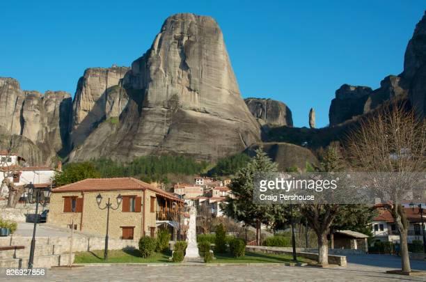 Park and houses below huge rock mountains of Meteora.