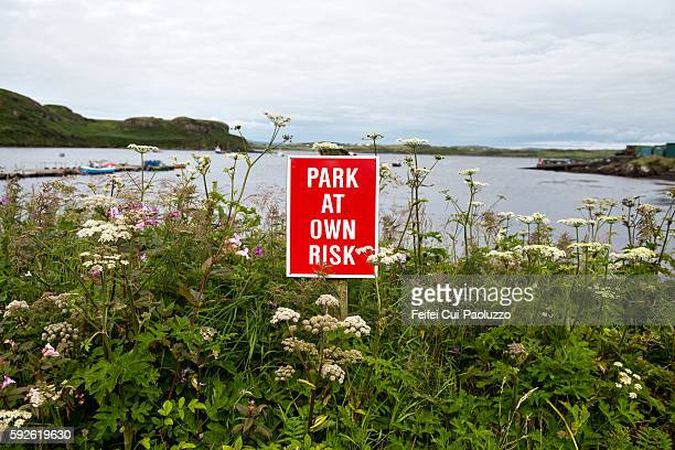 Park at own risk warming sign at harbor of Portnalong in Isle of Sky in Scotland