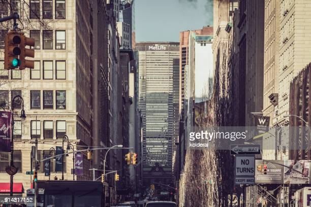 park avenue and union square at sunset. distance view of metlife building. manhattan, new york - metlife building stock pictures, royalty-free photos & images