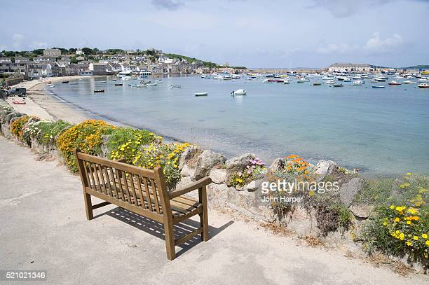park bench overlooking a marina at st. mary's - isles of scilly stock pictures, royalty-free photos & images