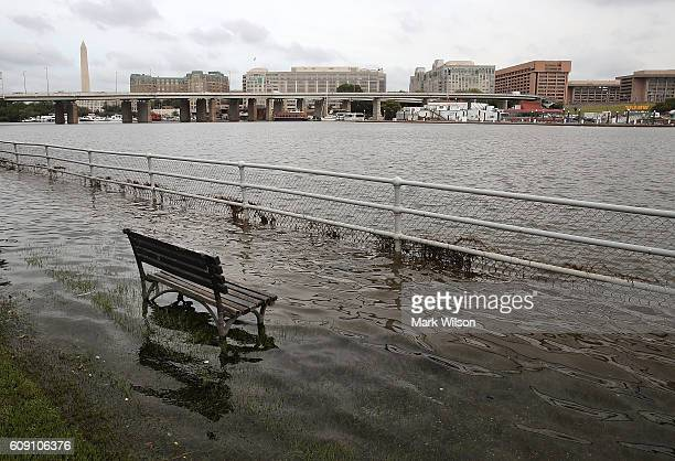 A park bench sits in the waters of the Washington Channel during a high tide September 20 2016 in Washington DC Nussiance high tides have become...