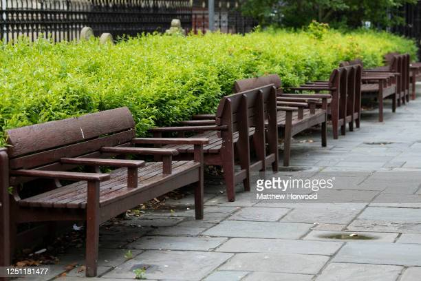 Park benches reversed to aid social distancing ahead of the re-opening of non-essential shops on June 21, 2020 in Cardiff, United Kingdom. The First...