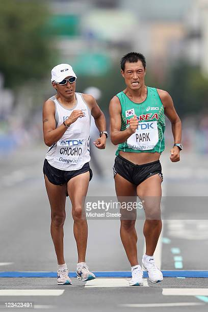 Park Chilsung of Korea and Andres Chocho of Equador compete in the Men's 50 kilometres Race Walk Final during day eight of 13th IAAF World Athletics...