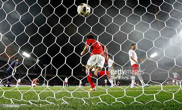 Park Chu-Young and Ji Dong-Won of South Korea celebrate after a goal during the 2014 FIFA World Cup Brazil Asian 3rd Qualifier match between South...