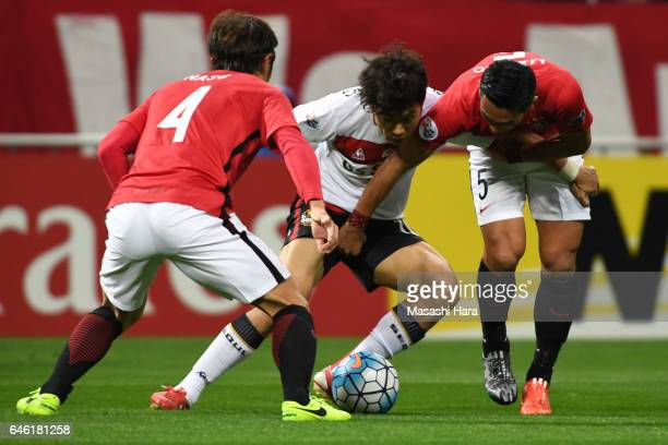 Park Chuyoung of FC Seoul and Tomoaki Makino of Urawa Red Diamonds compete for the ball during the AFC Champions League match Group F match between...