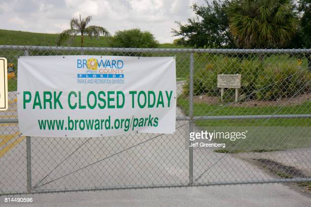 Park closed today sign at a park in Davie.