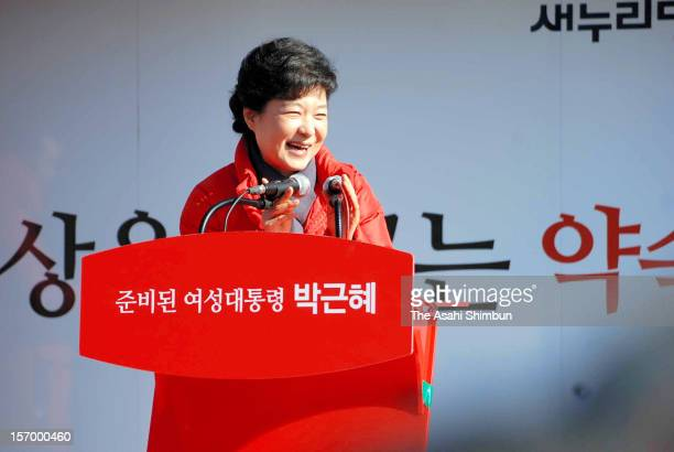 Park Geun Hye, presidential candidate from the ruling New Frontier Party waves to supportres on November 27, 2012 in Daejeon, South Korea. The voting...