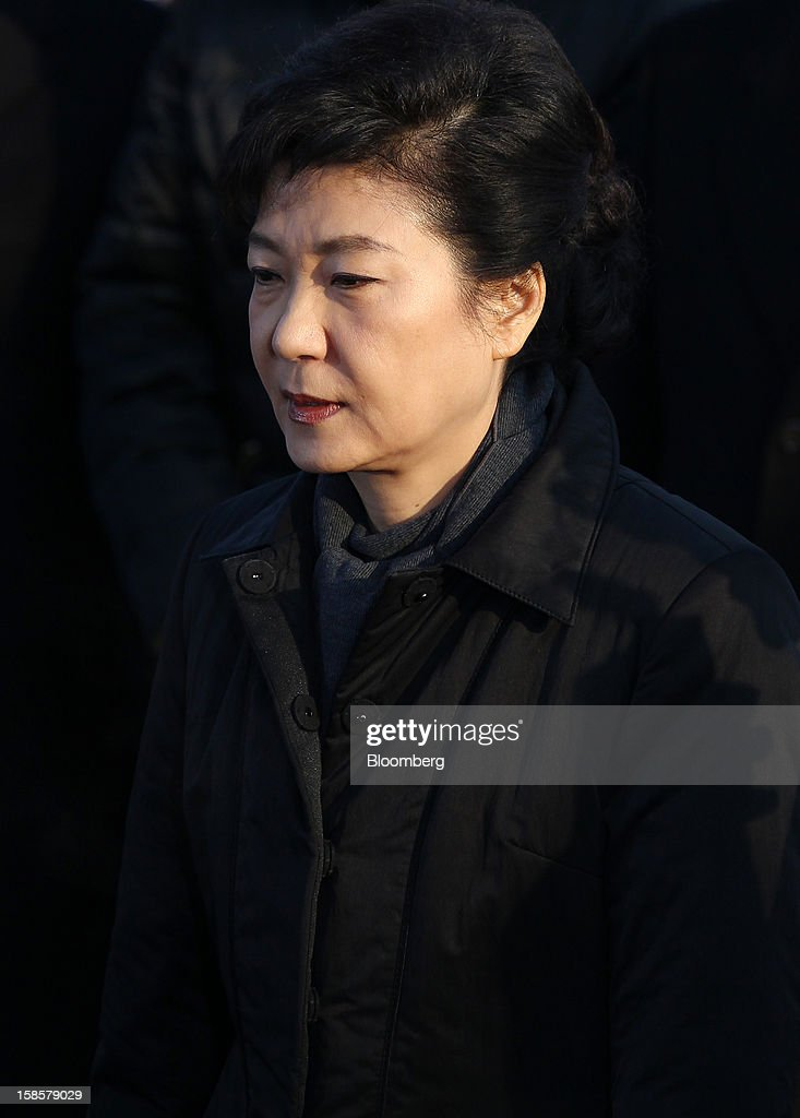 Park Geun Hye, South Korea's president-elect, visits the National Cemetery in Seoul, South Korea, on Thursday, Dec. 20, 2012. Park, 60, of the ruling New Frontier Party, defeated main opposition nominee Moon Jae In, 51.6 percent to 48 percent, the biggest margin of victory in 25 years. Photographer: SeongJoon Cho/Bloomberg via Getty Images