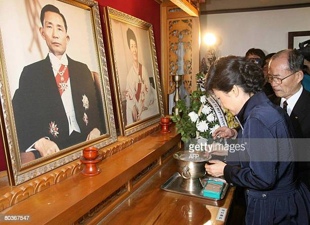 Park GeunHye a popular lawmaker of South Korea's ruling Grand National Party burns an incense for her father former president Park ChungHee at a...