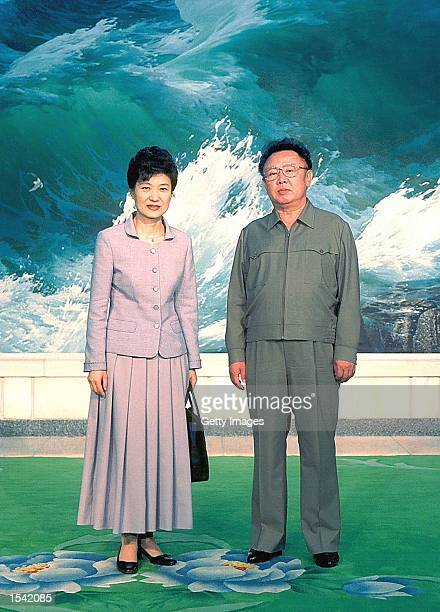 Park Geunhye daughter of South Korea's former military ruler Park Chunghee poses with North Korean leader Kim JongIl May 13 2002 in Pyongyang North...