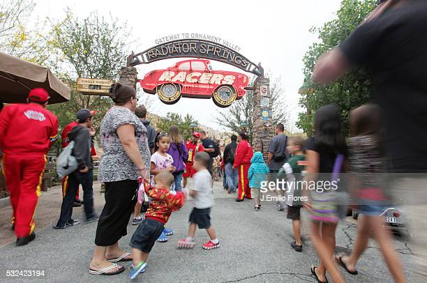 LOS ANGELES CA Park goers visit Carsland at Disney's new California Adventure Theme park which opened on friday June 15 2012 Photo by J Emilio...