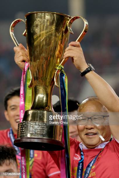 Park Hang Seo coach of Vietnam poses with the cup after defeating Malaysia 10 during the AFF Suzuki Cup final second leg match between Vietnam and...