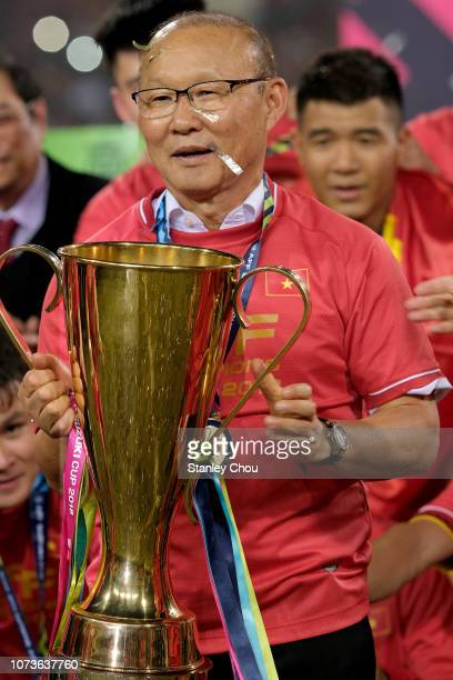 Park Hang Seo coach of Vietnam poses with the cup after they defeated Malaysia 10 during the AFF Suzuki Cup final second leg match between Vietnam...