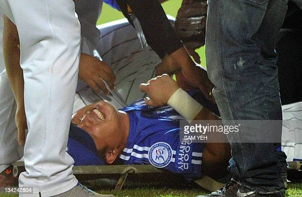 Park HanYi of South Korea's champions Samsung lions lies injured on the field in the game against Japan's champions Softbank Hawks during the 2011...