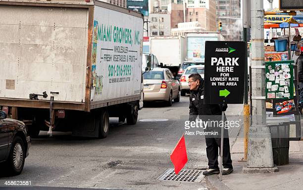 park here: parking attendant invite driver - parking valet stock photos and pictures