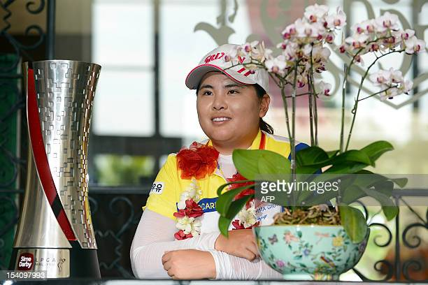 Park Inbee of South Korea poses with her trophy after winning the Sime Darby LPGA Malaysia 2012 golf tournament at the Kuala Lumpur Golf and Country...