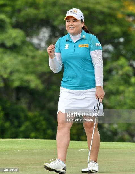 CORRECTION Park Inbee of South Korea reacts after sinking her last shot for 19underpar on the 18th hole during the final round of the HSBC Women's...