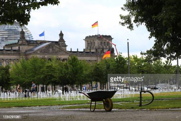 Park irrigation beside government buildings in Berlin, Germany, on Thursday, July 29, 2021. Germany reports gross domestic product figures on July...