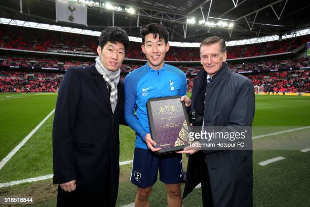Park Jisung and Andy Roxburgh present HeungMin Son of Tottenham Hotspur with the Asian footballer of the year award prior to the Premier League match...