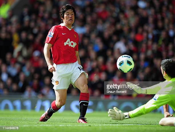 Park JiSung of Manchester United beats Matthew Gilks of Blackpool to scores their first goal during the Barclays Premier League match between...