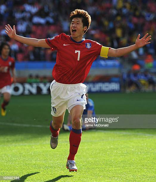 Park JiSung of South Korea celebrates scoring the second goal during the 2010 FIFA World Cup South Africa Group B match between South Korea and...