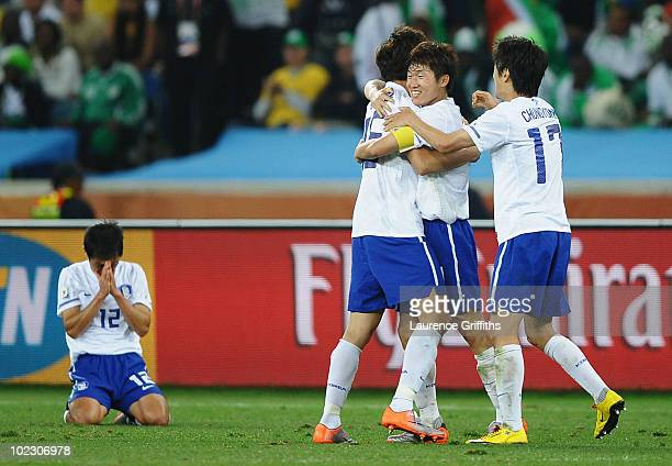Park JiSung of South Korea celebrates with teammates after a draw gives them victory and progress to round two in the 2010 FIFA World Cup South...