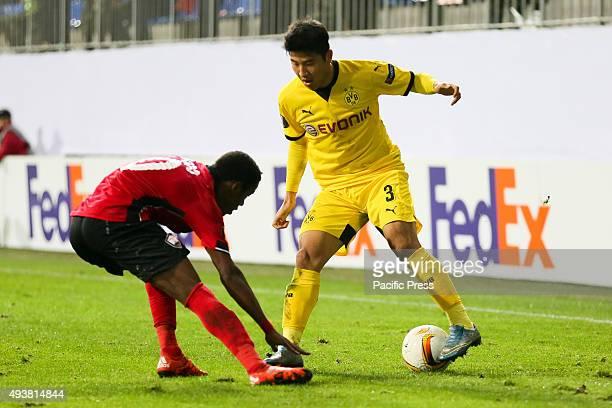 Park Joo Ho of Borussia Dortmund in action against Dodo of Qabala during the UEFA Europa League match between Qabala FK and Borussia Dortmund at...
