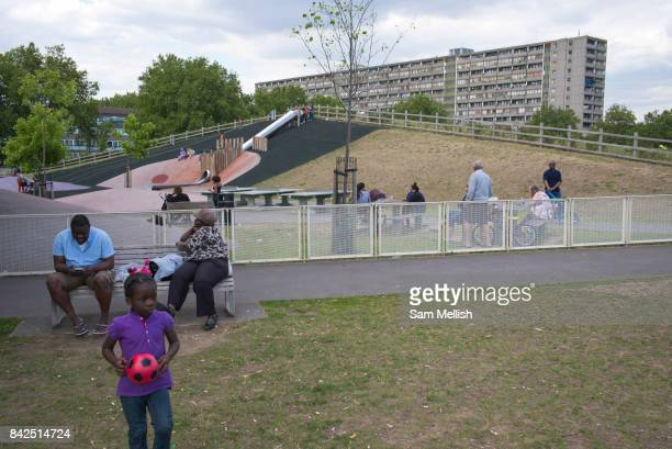 Park life in Burgess Park playground on 31st July 2015 in South London United Kingdom On the horizon is the Aylesbury Estate a large housing estate...
